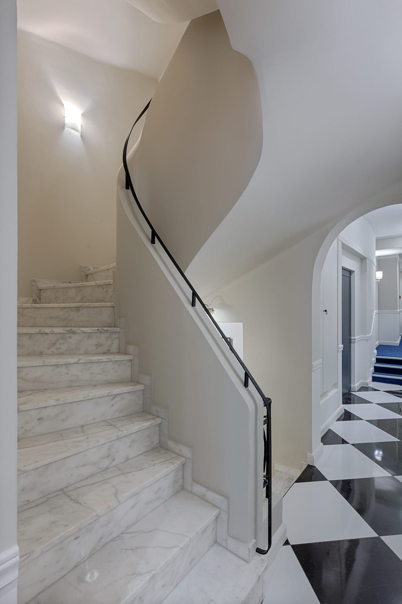 Winding staircase leading up and down the different floors of the Classic by Athens Prime Hotels.