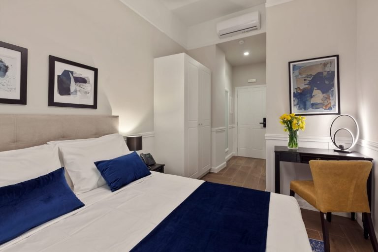 Inside one of the rooms of the Classic by Athens Prime Hotels. Double bed with blue pillows.