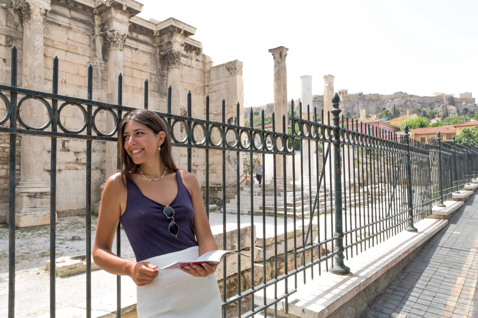 Girl visiting famous Ancient Greek landmarks in the historical centre of Athens.