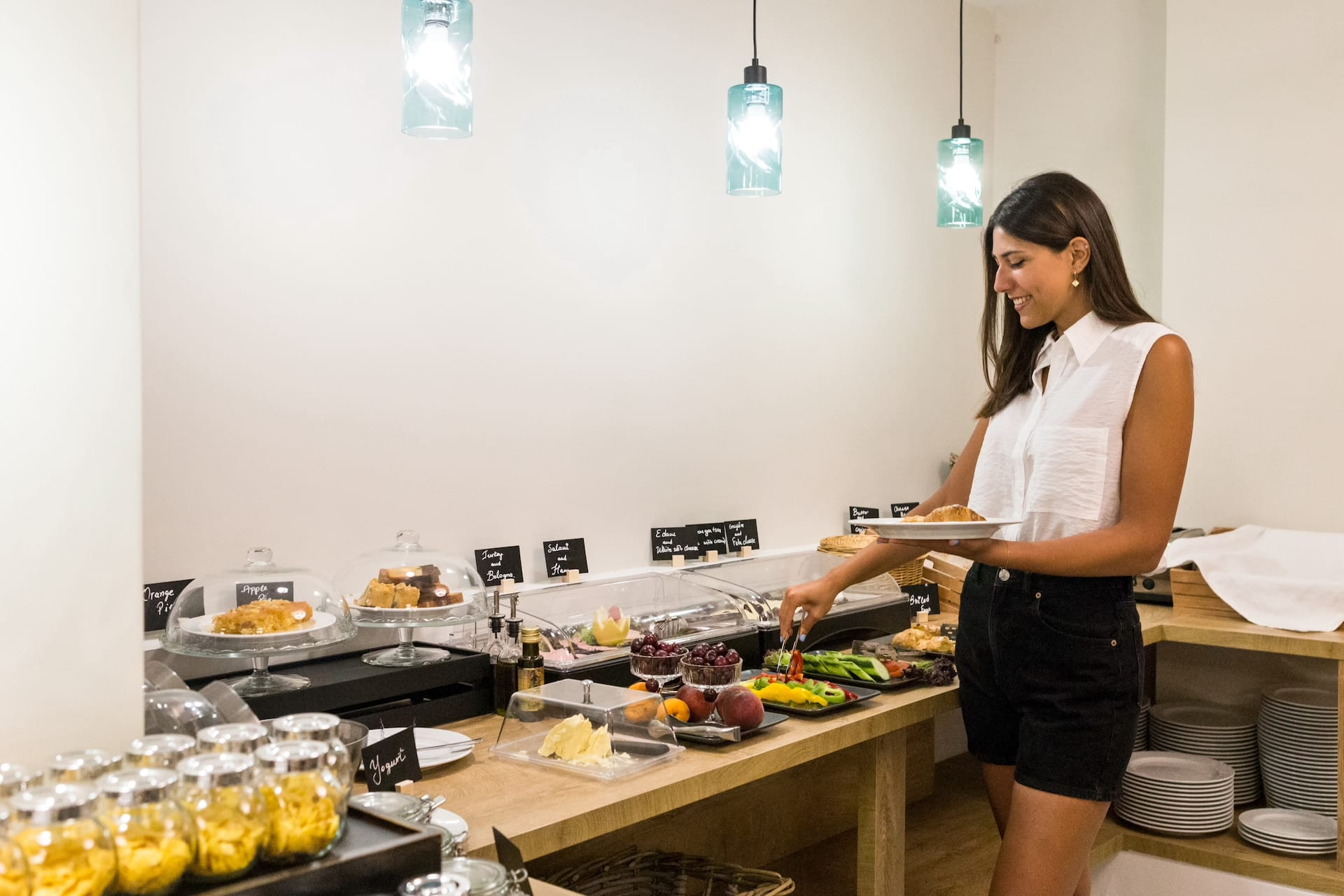 Woman enjoying her breakfast at the Classic by Athens Prime Hotels buffet