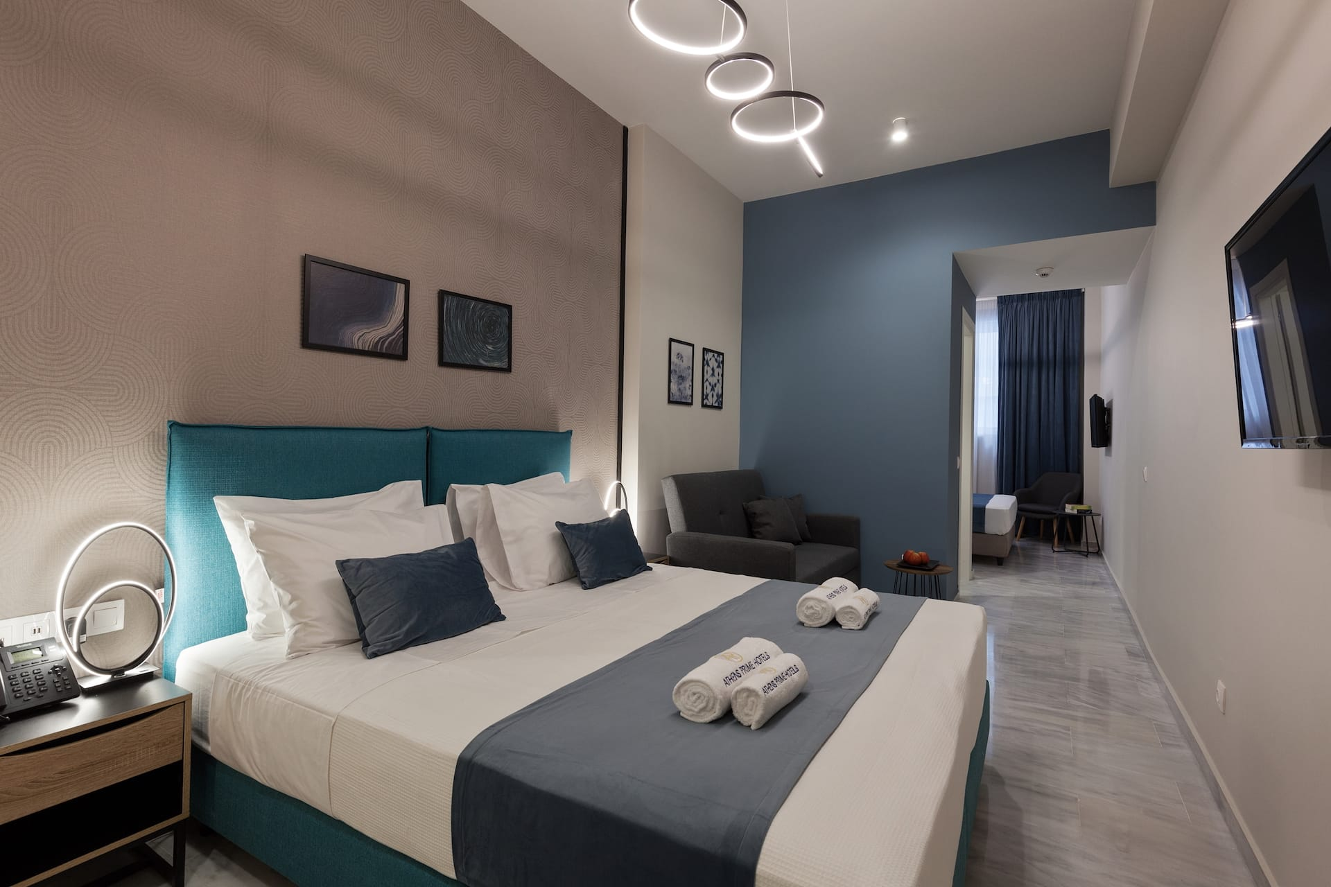 Inside one of the rooms of the Trendy by Athens Prime Hotels. Double bed with white & blue pillows.